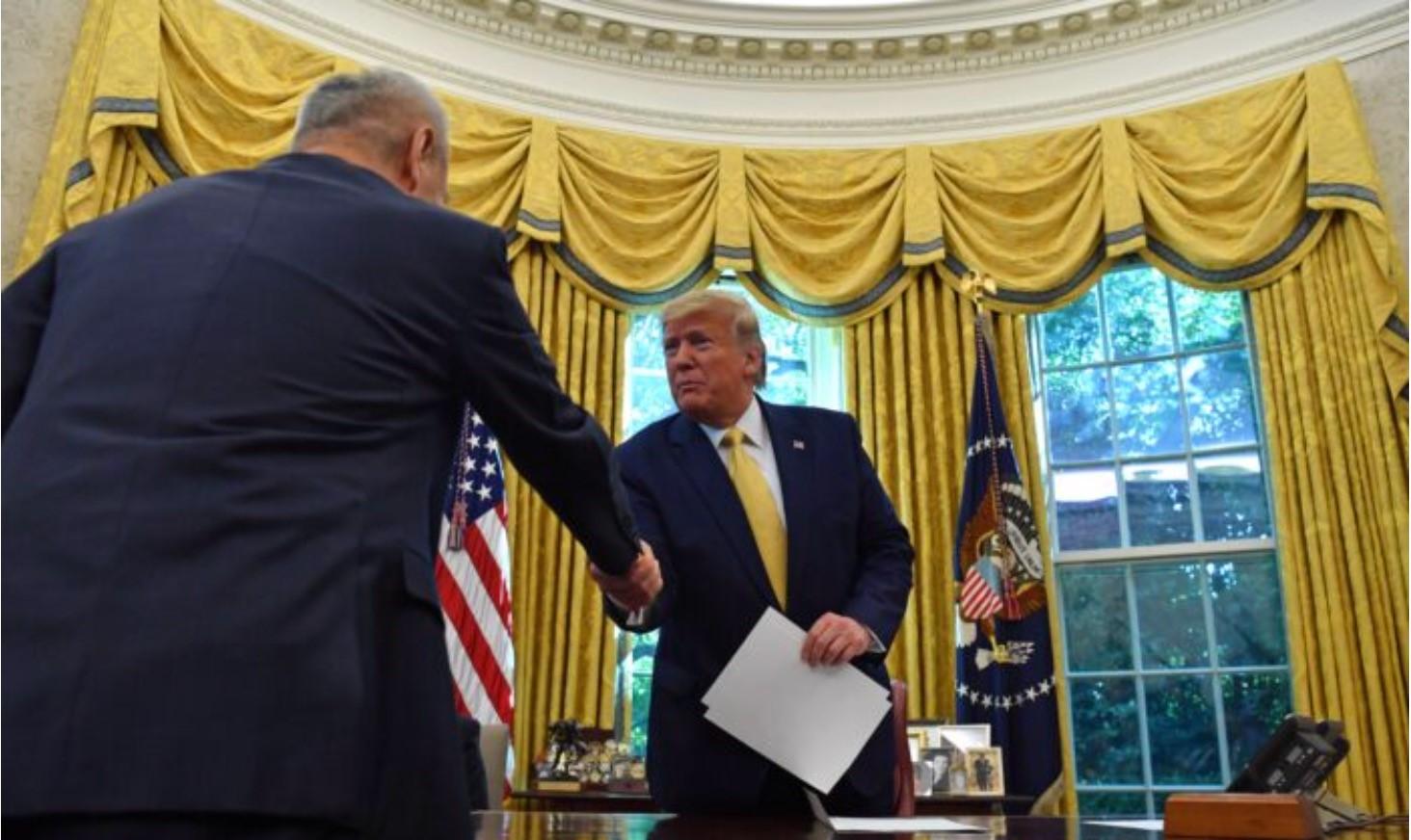 10月11日,在美國將要就人權法投票前夕,中美在華盛頓達成了有限的貿易協定。(Nicholas Kamm / AFP via Getty Images)