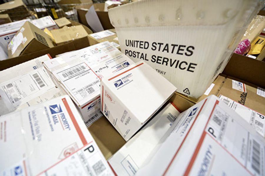 在美國退出萬國郵聯的壓力下,萬國郵聯在9月第三次特別大會做出的國際小包終端費改革的決定,中國等將逐年增加向美國及其它國家支付的國際小包終端費,2020年調漲27%,以後每年漲15%~17%,到2025年將總計漲164%。(Brian Kersey/UPI/大紀元資料室)