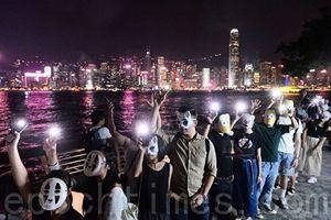組圖:港民戴面具築人鏈 抗議《禁蒙面法》