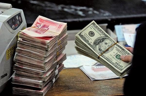 專家表示,即使中美兩國簽署第一階段貿易協議,人民幣兌美元匯率也將持續保持在7以上。(AFP)
