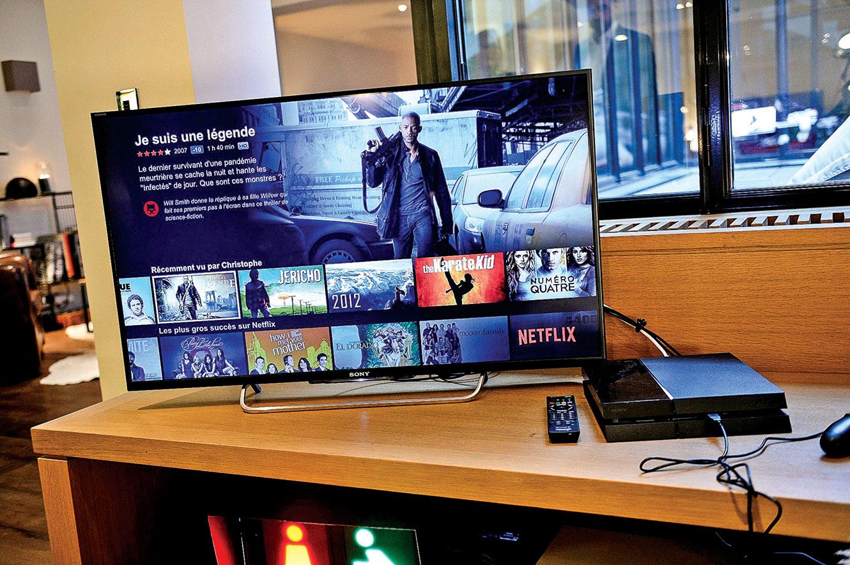 影音串流節目五花八門,每家的節目都很精采,應如何挑選呢?圖為2014年Netflix在法國的推廣活動。(AFP)