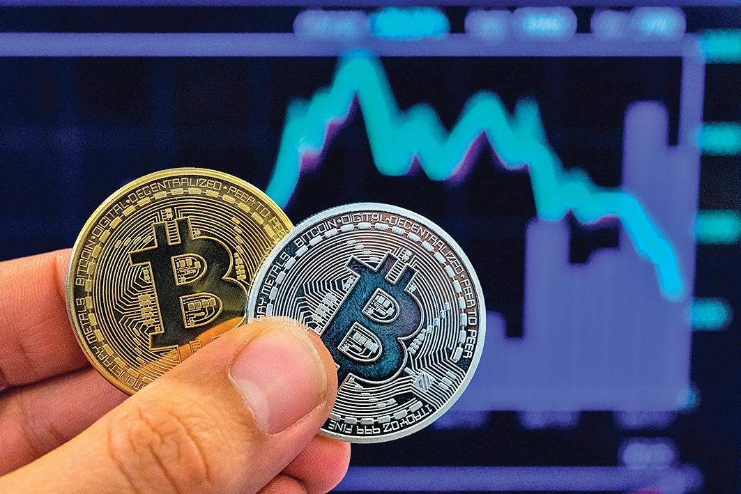 習近平表示將推動區塊鏈產業生態系,讓比特幣及區塊鏈概念股大漲,不過隔天又下跌。(Getty Images)