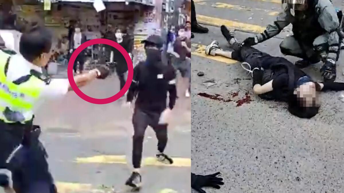 11月11日早上7點多鐘,一名交通警察朝手無寸鐵的年輕示威者連開3槍,致2人中槍倒地。(影片截圖)