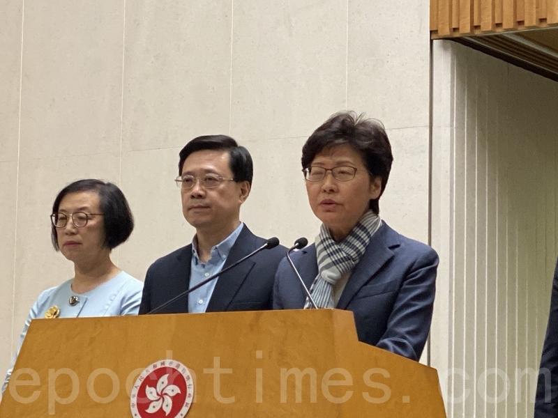 香港民研最新調查顯示╴林鄭月娥的計分再創新低。食物及衛生局局長陳肇始(左)是最新支持率淨跌幅最大的局長,保安局局長李家超(中)是支持率淨值最低的局長。(大紀元資料圖片)
