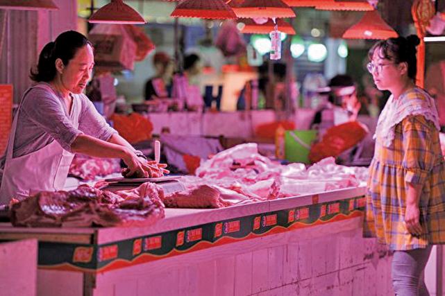 2019年8月22日,安徽淮北市一市場內的豬肉攤位。(Getty Images)