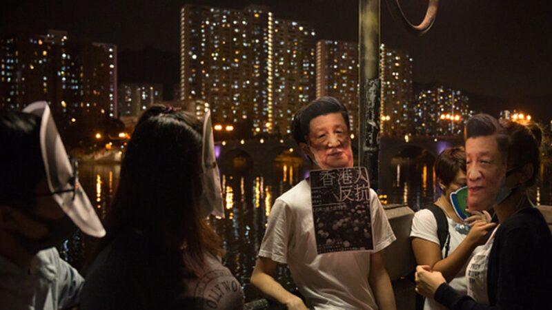 香港人戴著習近平頭像面具以示抗議。(Billy H.C. Kwok/Getty Images)