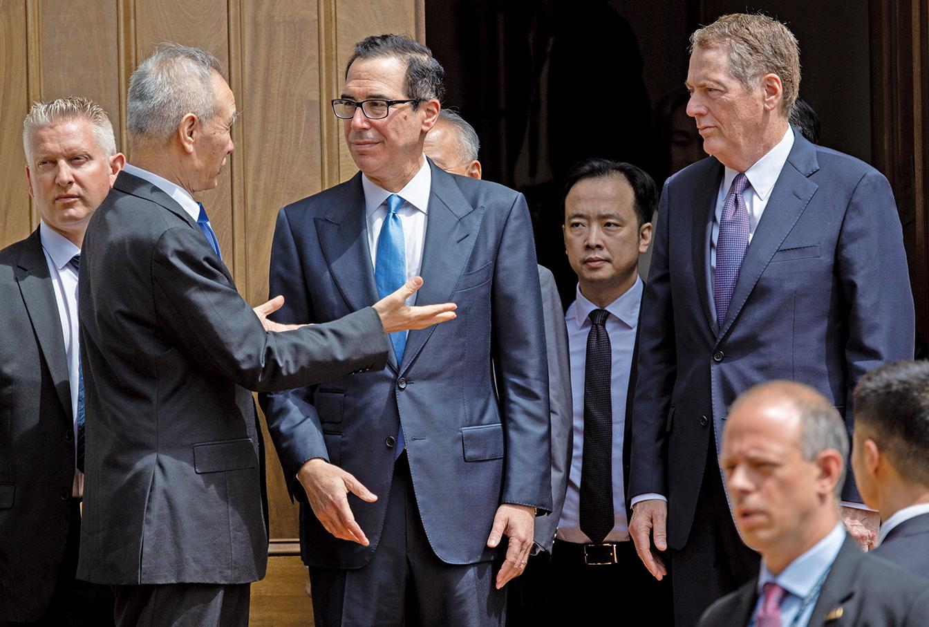 路透社11月20日透露,中美第一階段貿易協議有可能會拖到明年。圖為中美談判資料圖。(AFP)