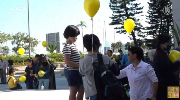 圖為12.01「孩子不要催淚彈」親子集會及小型遊行。(影片截圖)