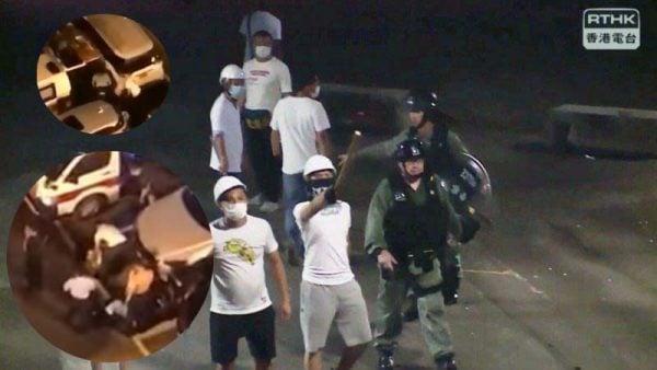 7月21日晚,港人拍到警察和白衣黑幫同行。(影片截圖)