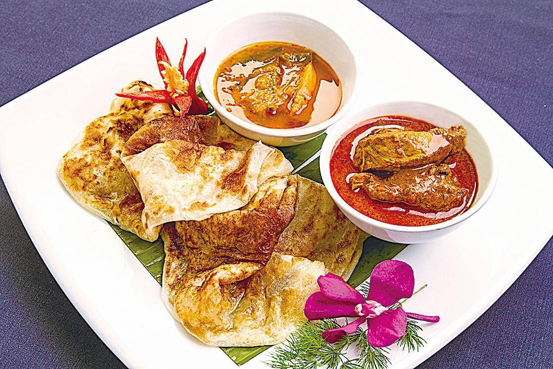 香烤後的餅沾上印度咖哩,是最經典的印度風味。