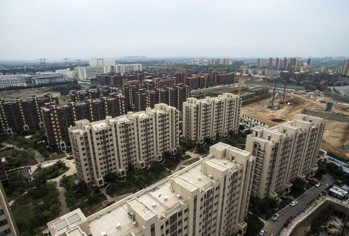 中國的房市泡沫,正在破裂中,系統性金融風險隨時會引爆。(FRED DUFOUR/AFP/Getty Images)