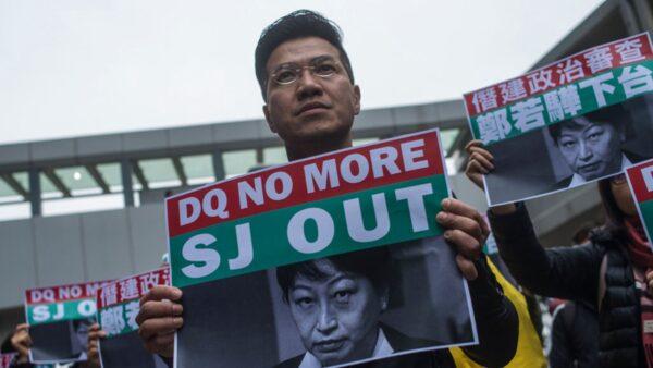 香港律政司司長鄭若驊丈夫潘樂陶公司被調查,港人一再要求鄭若驊下台。(PHILIP FONG/AFP via Getty Images)