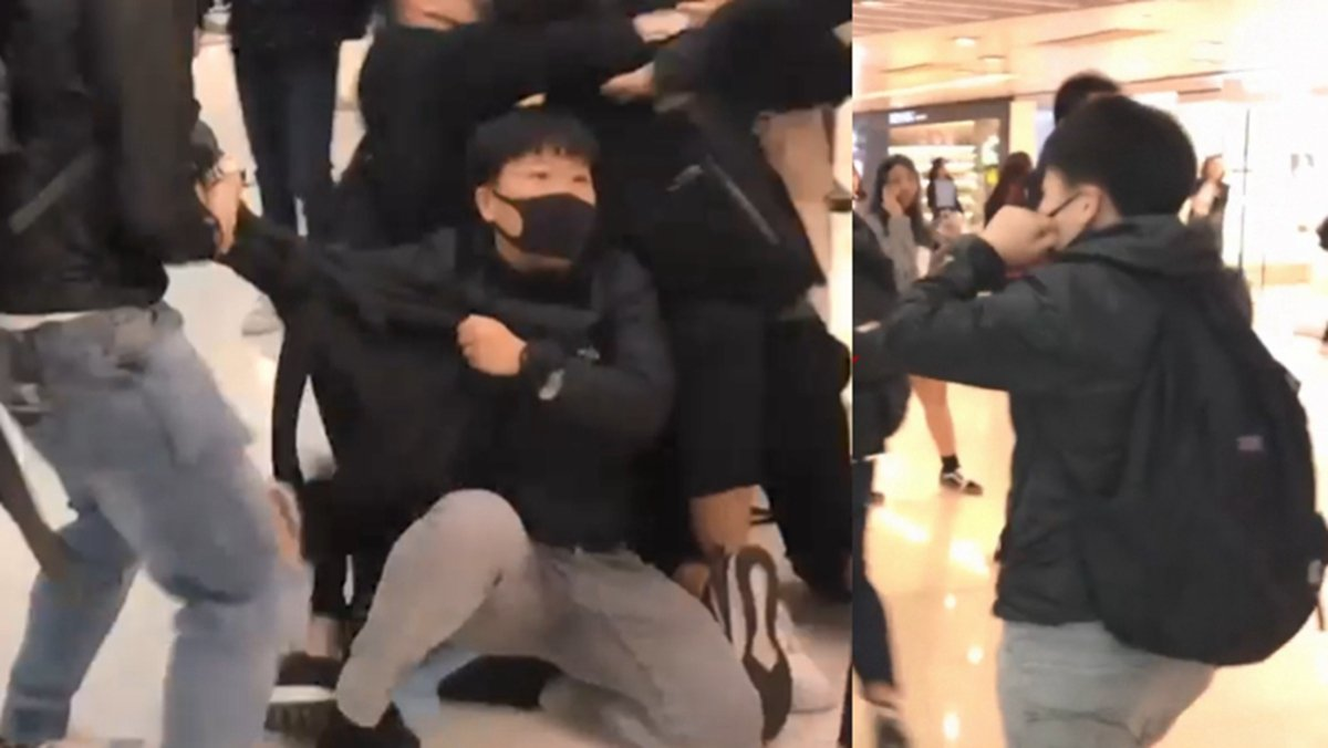 1名身形較矮小的蒙面警員被包圍,逃離後一度摘下口罩。(理大校園電台提供)