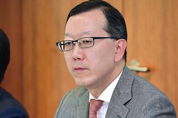 瑞銀UBS集團董事總經理暨亞太區投資銀行主管金弘毅。(郭威利/大紀元)