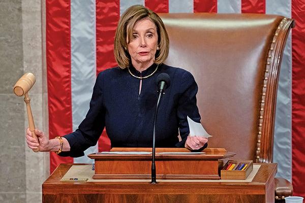 眾議院議長佩洛西當地時間星期三晚主持針對特朗普的彈劾投票。(SAUL LOEB/AFP via Getty Images)