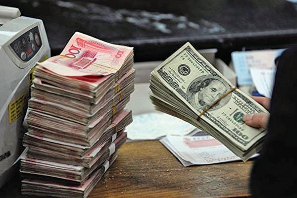 大陸央行此次全面降準將釋放8,000多億元人民幣長期資金。(STR/AFP/Getty Images)