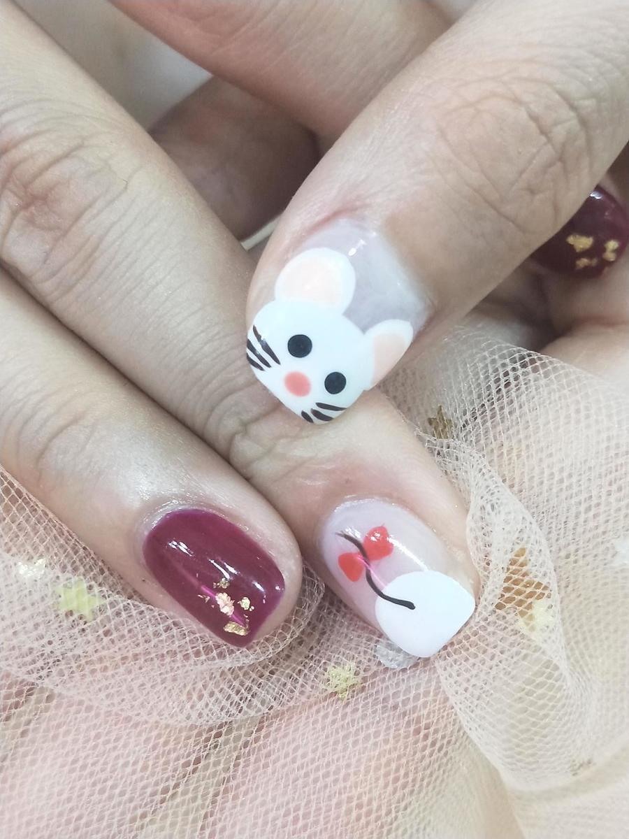 今年是鼠年,多款可愛小鼠造型適合活潑風趣的女性。(Suki Nail提供)