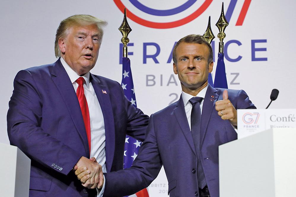 美國總統特朗普及法國總統馬克龍周一達成貿易休戰共識,美法休戰化解了歐洲和美國全面開打貿易戰的危機。(AFP)
