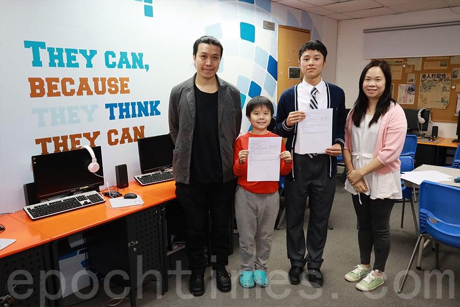 林建東(左一)和李玉娟(右一)都是兩位學生的老師,學生稱讚他們傳授的記憶法對學習十分有效。(陳仲明/大紀元)
