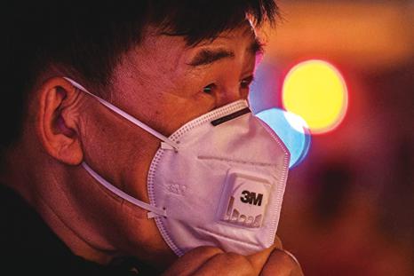 武漢肺炎擴散,何時見到曙光?(Kevin Frayer/Getty Images)