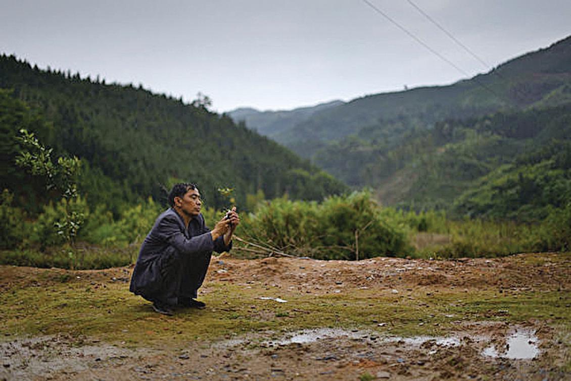 中共早前隱瞞肺炎疫情,令疫情擴散,中共封城應對,企業預計新年後農民工返工數量將大減。圖為湖南農村。(AFP/AFP via Getty Images)