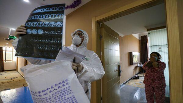 武漢疫情之下,一些中共高官染病被隔離或死亡。示意圖(STR/AFP via Getty Images)