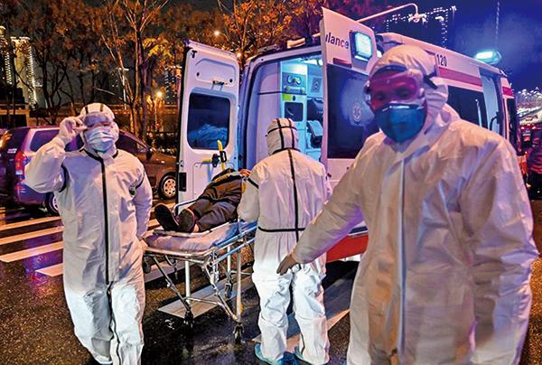 現在國外科技界普遍認為,武漢新冠病毒95%可能是人工合成出來的,很可能來源於武漢P4病毒實驗室。(AFP)