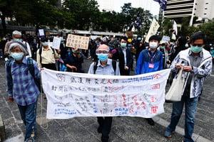 【圖片新聞】銀髮族遊行促政府交代CSI口罩去向