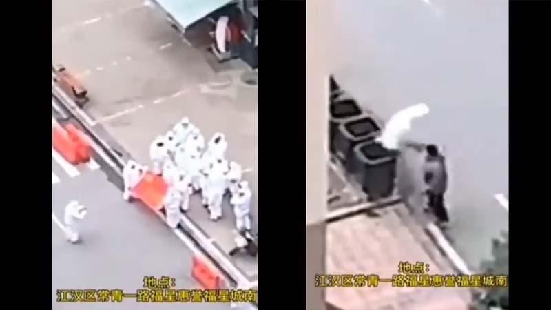武漢黨官集體擺拍邀功 拍完脫下防護服就扔