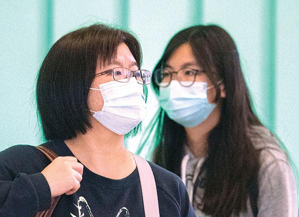 1月29日,從疫情已經開始爆發的地區抵達洛杉磯機場的旅客。圖中人物與本文無關。(AFP)