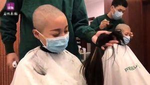 大陸護士變死士 支援疫區前含淚削髮訣別(影片)