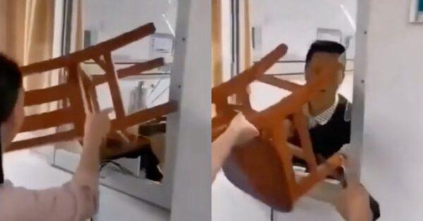 一名患者在醫院隔離室精神崩潰,打碎玻璃想逃走。(影片截圖)