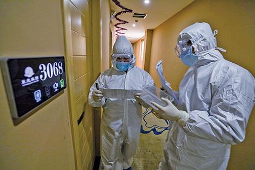南韓半導體大廠SK海力士有一名員工出現肺炎症狀,為防止疫情擴散,該公司對800名員工進行居家隔離。(Getty Images)