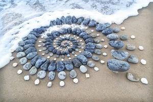 海浪下石頭作品一天被沖毀 藝術家仍創作不息