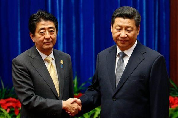 分析日媒報道,似乎應由中方主動提出習近平延後訪日最好。( AFP/Getty Images)