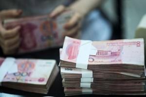 經濟學家:大陸現狀下拿現金的人最吃虧