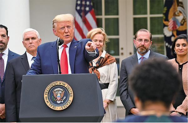 美國總統特朗普周五(13日)宣佈美國進入緊急狀態,所有用於控制和治理疫情的資金和資源,將以最快速度到位。(AFP)