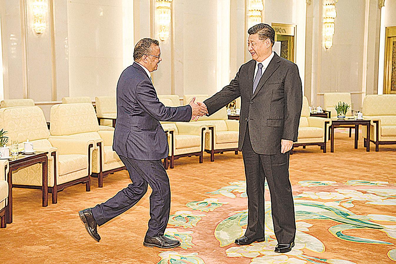 1月28日世衛組織秘書長譚德賽在北京受到習近平的接見。(Getty Images)