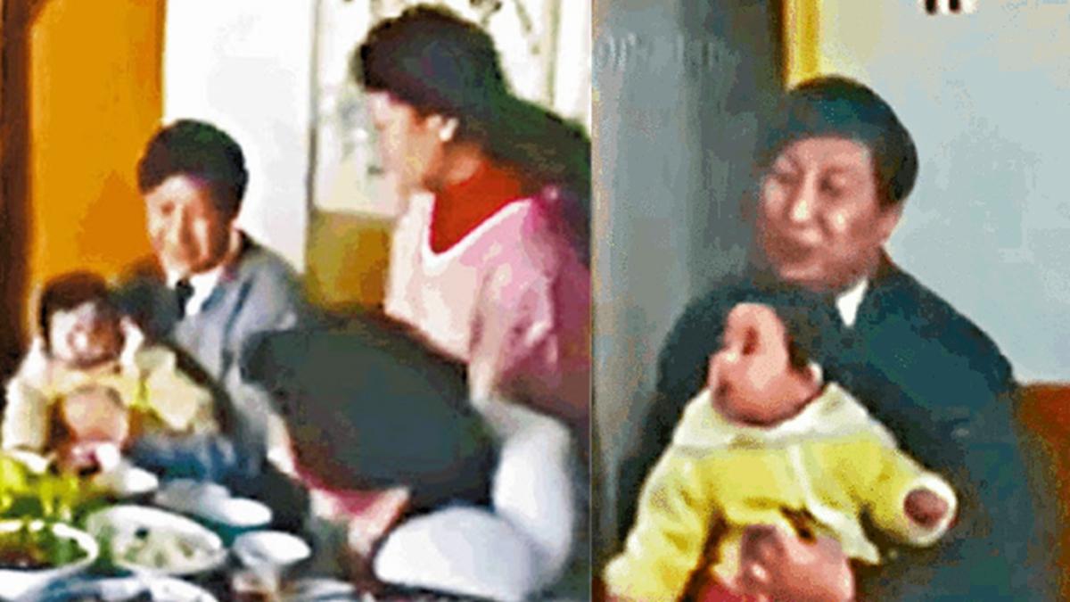 網上傳出一段90秒的影片,內容是習近平早年抱著女兒習明澤,與妻子彭麗媛一起接受採訪的畫面。(影片截圖)