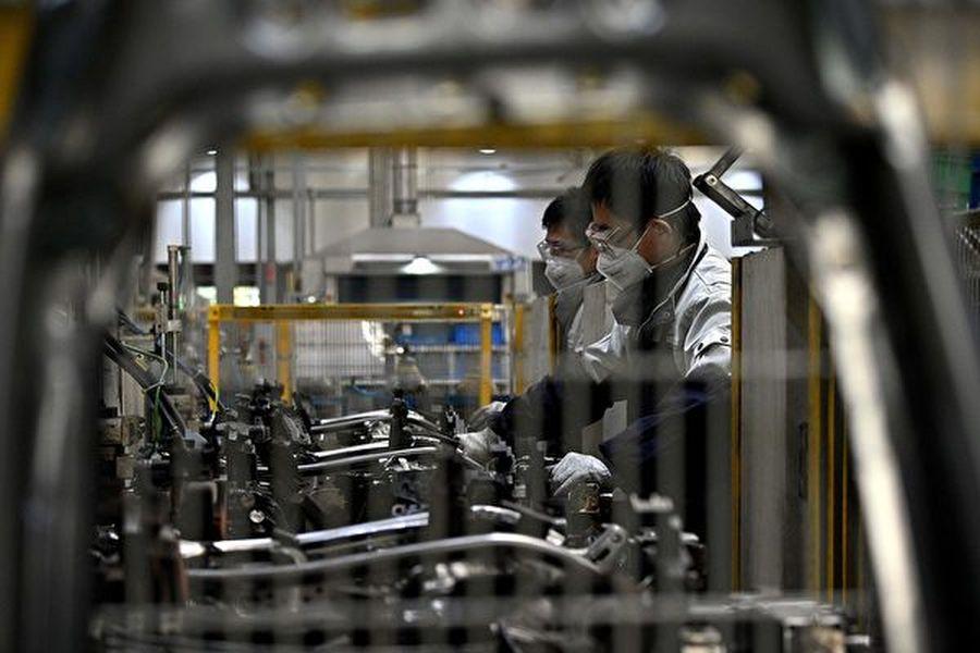 圖為受疫情影響下的中國工廠。(NOEL CELISAFP via Getty Images)