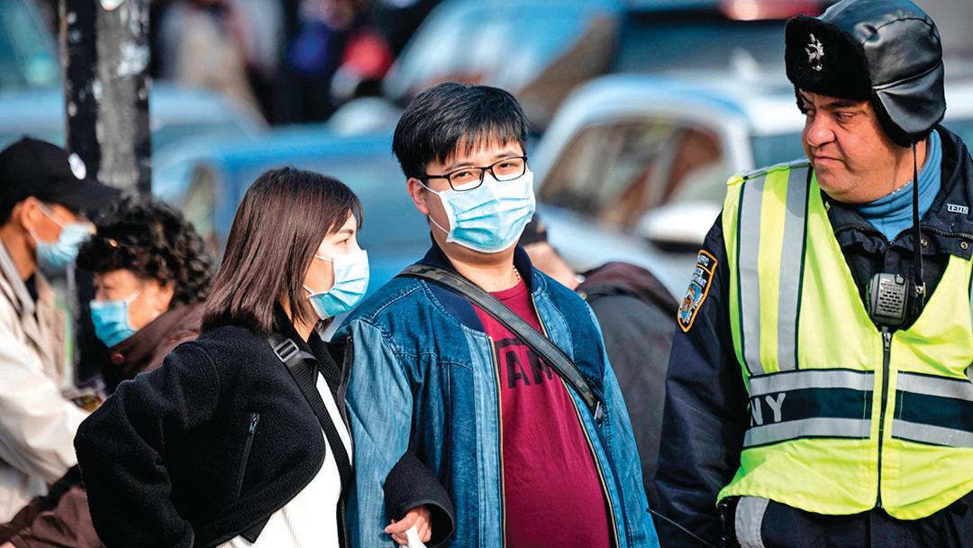 中共「小粉紅」們對美國疫情的幸災樂禍,令500萬在美華人面臨險境。示意圖。(AFP)