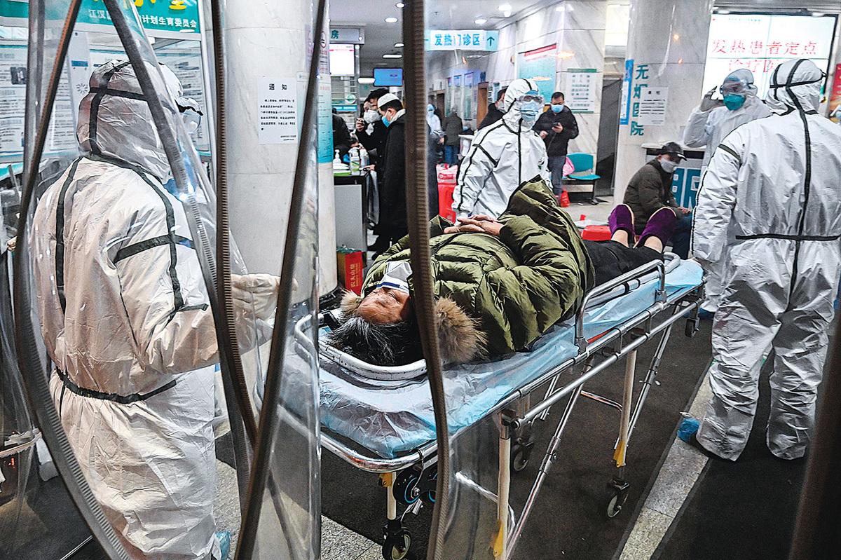中共儘管內部提前做了通告,但卻沒有採取措施保護民眾,導致疫情在武漢大爆發。(AFP)