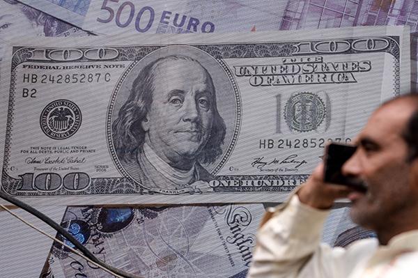 美元在過去四天交易中雖然沒能繼續延續其相對日圓的強勢,但也維持在107日圓以上的高價位。(Getty Images)