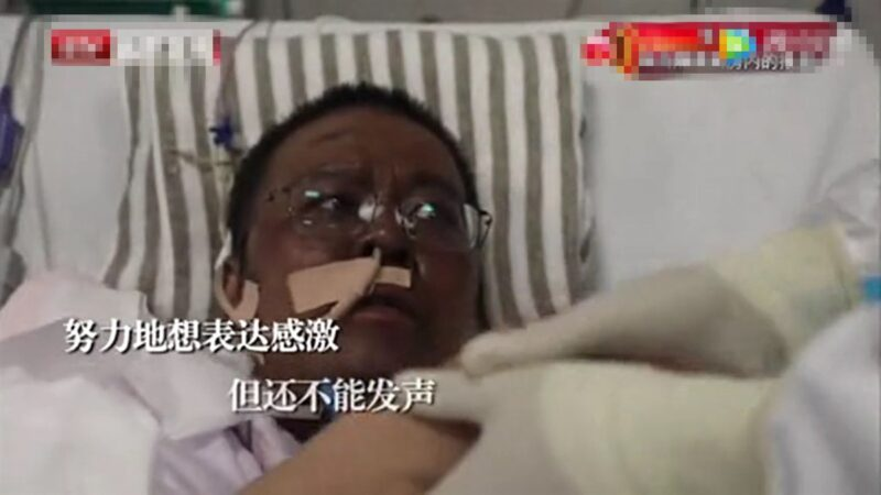 兩名感染中共病毒的武漢醫師雖然逃過死劫,卻全身暗沉整臉發黑。(視頻截圖)