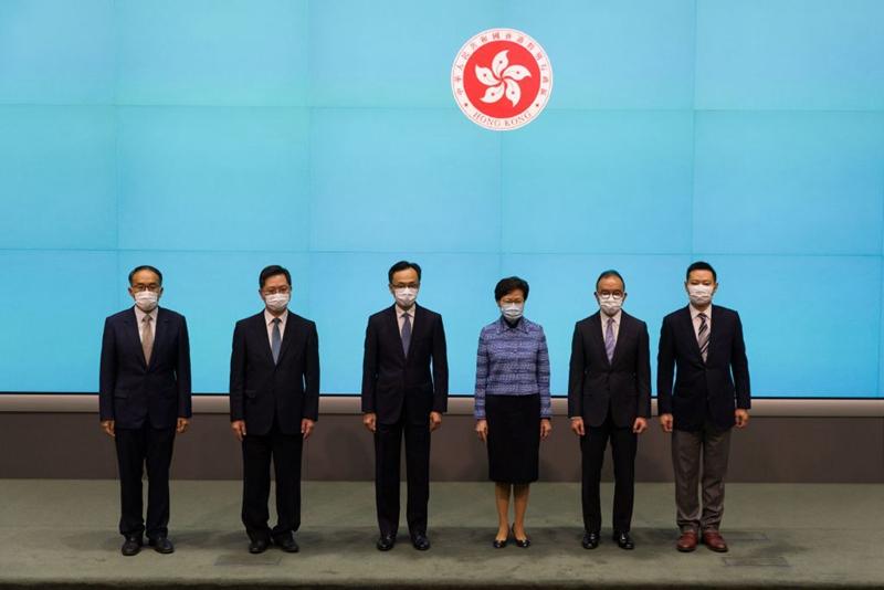 4月22日中午12時,特首林鄭月娥與5名新任局長召開記者會。 (STR/AFP via Getty Images)