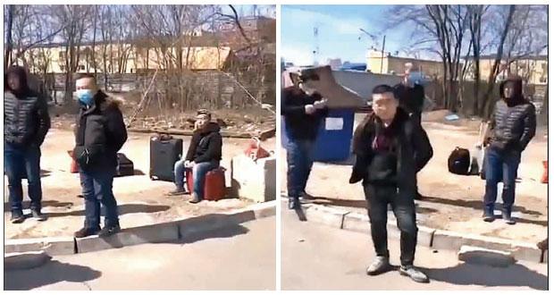 4月11日的社媒影片顯示,31名中國人在俄國海蘭泡街上被困多天,遙望一江之隔的黑河,呼籲祖國允許他們回國。(影片截圖)