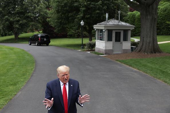 美國總統川普21日在白宮公開回應說,如果中共推行「港版國安法」,「我們的處理會非常強烈」。 (Alex Wong/Getty Images)