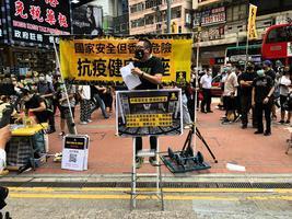 【5.24銅鑼灣遊行】「國安法就是黨安法」人民力量譚得志遭防暴拘捕