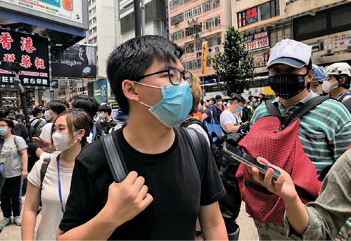 香港眾志秘書長黃之鋒認為,中共要實施「港區國安法」,表明香港的「一國兩制」已經完結,「一國一制」的時代已在香港開啟。(梁珍/大紀元)