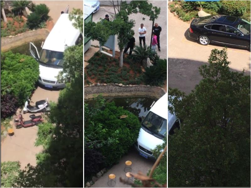 守在王藏家樓下的警察和車輛。(王麗推特)